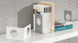 white and silver bookend