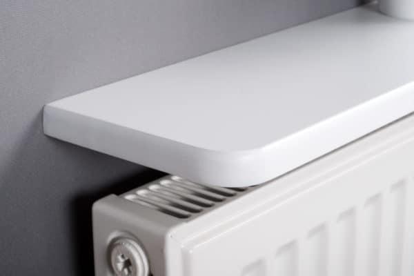 White rounded radiator shelf