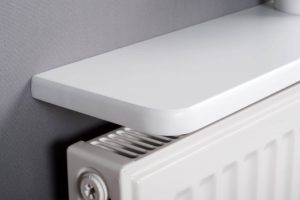 White rounded radiator shelf